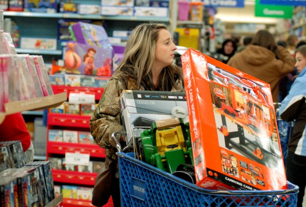 Nicole Estey of New Brunswick fills her cart at Toys R Us shortly after midnight on Black Friday. The toy store allowed 200 customers in at a time.