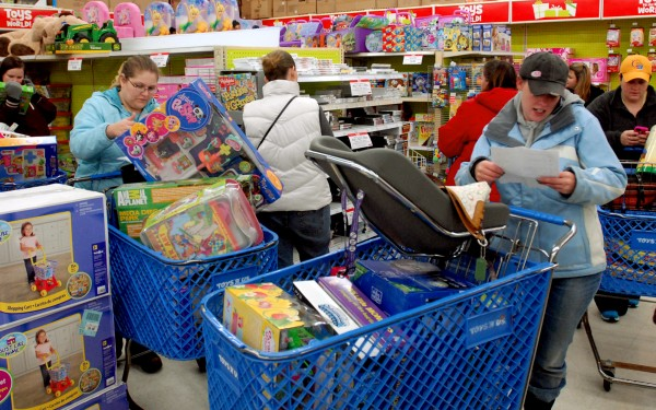 Customers at Toys R Us check their shopping lists and load their carts on Black Friday in Bangor.