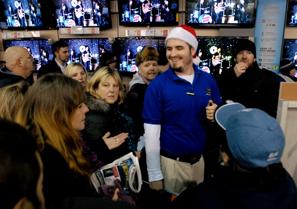 Customers swarm around Best Buy employee Ben Bambrick in search of TVs on Black Friday in Bangor.