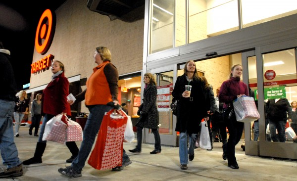 Patrons come out of Target with their purchases early on Black Friday in Bangor.