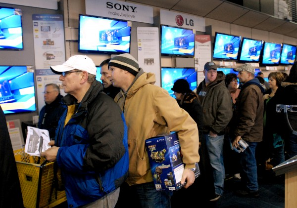 Customers line up at Best Buy waiting for the TVs they received tickets for while wating in line outside the store. The store gave out tickets for their hot items to customers who were waiting in line.