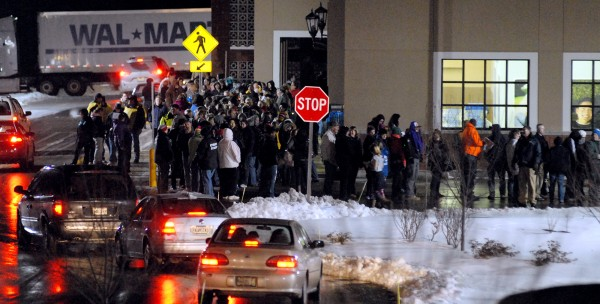 Customers lined up around both ends of the Bangor Walmart on Thursday waiting for the doors to open at midnight.