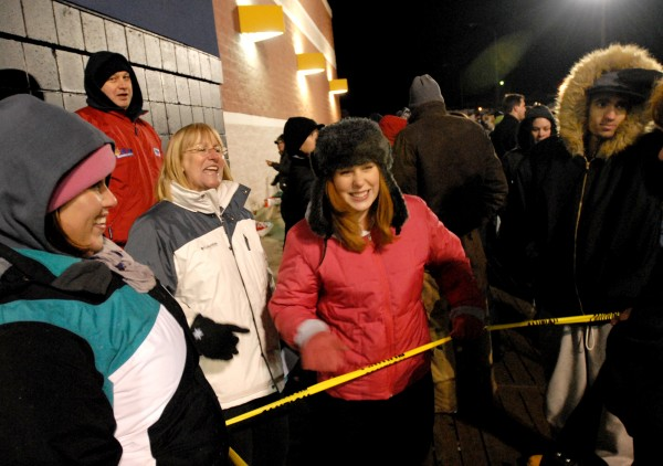 Amy Shawley (left to right), Guy Currier, Beverly Commeau, Kayla Currier, and Jake Kipping, all from the Old Town area, have a good time listening to music outside of the Bangor Best Buy while waiting for the doors to open at 12:01am on Black Friday.