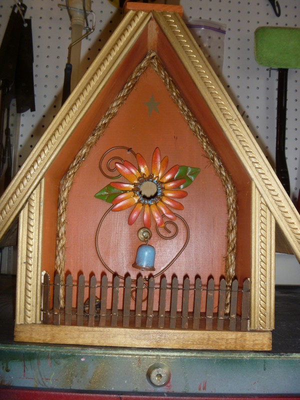 Ken St. John of Bangor added whimsy to a birdhouse he built by trimming it with decorative molding, a picket fence and metal bell.