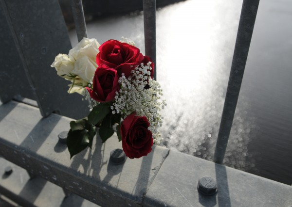 Roses placed in the gaurd rail of the Penobscot Narrows Bridge on Monday, Nov. 14, 2011, mark the spot where the Rev. Bob Carlson is believed to have jumped off on Sunday.