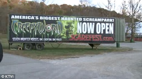 A banner on a tractor-trailer advertises Creepyworld in Fenton, Mo., where a 17-year-old girl accidentally hung herself on Thursday, Oct. 27, 2011.