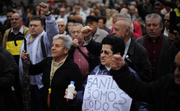 Pensioners and patients protest during the second day of the health workers strike in Bellvitge, Spain, Wednesday Nov. 16. Doctors in the Catalonia region called a mass strike at hospitals and outpatient departments to protest against planned cutbacks.