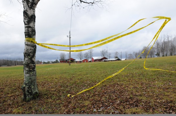 Crime scene tape flies in the wind at the Piscataquis Valley Fairgrounds on Wednesday, Nov. 30, 2011. Michael Curtis was gunned down by police at this location on Tuesday after shooting and killling Udo Schneider only moments earlier.