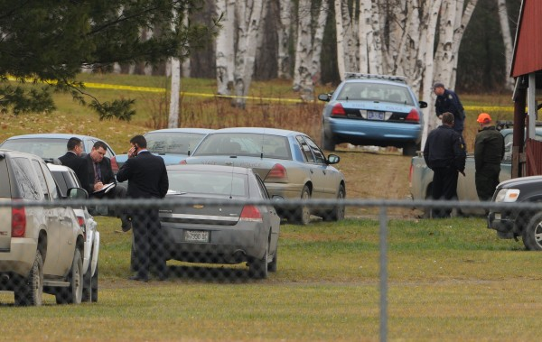 Maine State Police detectives and other local law enforcement personnel are seen at the Piscataquis Valley Fairgrounds in Dover-Foxcroft on Tuesday, Nov. 29, 2011, to investigate the police shooting of Michael Curtis of Sangerville.