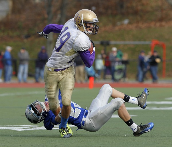 Chevrus' Louis DiStasio breaks a tackle  by Lawrence's Aaron Lafrance after making a second-quarter catch during the Class A state championship football game, Saturday, Nov. 19, 2011, at Fitzpatrick Stadium in Portland.