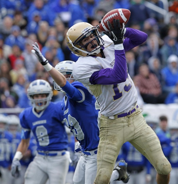 Cheverus' Louis DiStasio makes long reception in the first quarter during the Class A state championship football game, Saturday, Nov. 19, 2011, at Fitzpatrick Stadium in Portland.