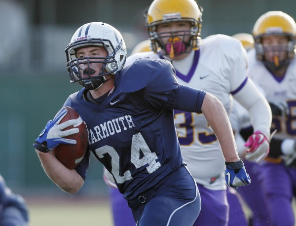 Yarmouth's Anders Overhaug rushes for the first of his six touchdowns against Bucksport in the Class C state championship football game, Saturday, Nov. 19, 2011, at Fitzpatrick Stadium in Portland.
