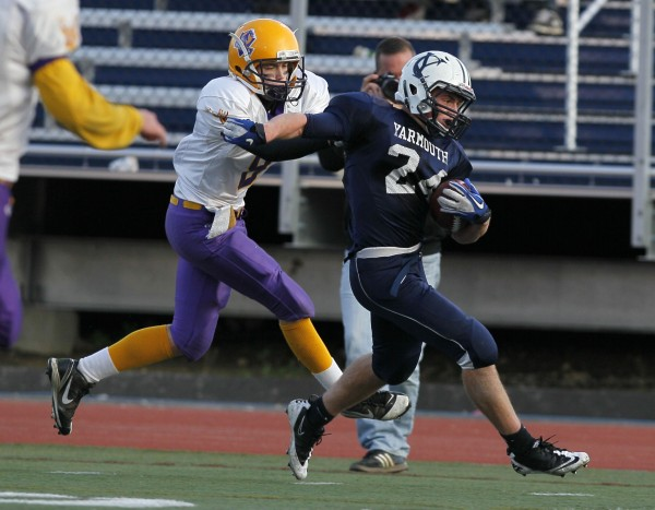 Bucksport's Jonathan Geagan, left, can not bring down down Yarmouth's Anders Overhaug who went onto score one of his six touchdowns in the Class C state championship football game, Saturday, Nov. 19, 2011, at Fitzpatrick Stadium in Portland.