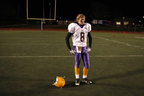 Bucksport's Jonathan Geagan stands dejected after losing to Yarmouth in the Class C state championship football game, Saturday, Nov. 19, 2011, at Fitzpatrick Stadium in Portland.