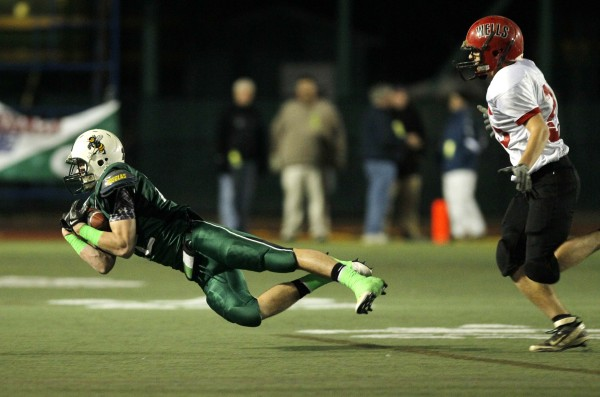 Leavitt's Ian Durgin makes a diving catch  while being defended by Wells'Douglas McLean in the Class B state championship football game, Saturday, Nov. 19, 2011, at Fitzpatrick Stadium in Portland.