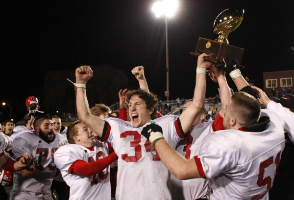 Wells' captain Lou DiTomasso, center, leads his team in a celebration after winning the Class B state championship football game over Leavitt, Saturday, Nov. 19, 2011, at Fitzpatrick Stadium in Portland.