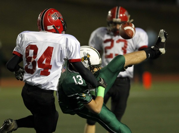 Leavitt's Brian Bedard, center, has a pass broken up by Wells defender Justin Lareau (84) during the Class B state championship football game, Saturday, Nov. 19, 2011, at Fitzpatrick Stadium in Portland.