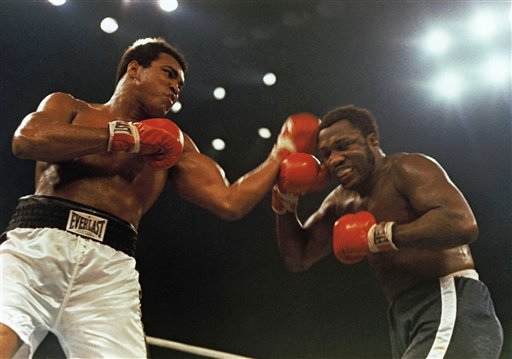 Muhammad Ali, left, and Joe Frazier fight in a 12-round nontitle fight at Madison Square Garden in New York on Jan. 28, 1974.