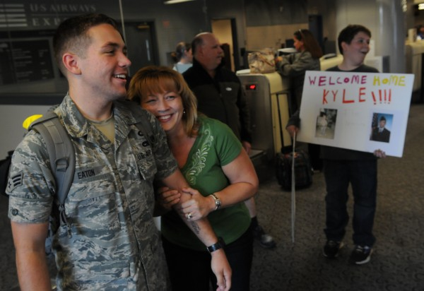 Cheryl Eaton (right) clutches her son Kyle Eaton at the Bangor International Airport on Friday, Nov. 4, 2011. Eaton was returning home after a six-month deployment. His family helped him purchase and furnish his first home on Parker Street in Bangor while he was overseas.