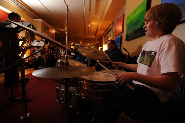 Maxx Meether, 12, of Hampden smiles as he plays drums along with other muscians at Nocturnem Draft Haus in Bangor on Tuesday, Nov. 22, 2011. Maxx is taking lessons from house drummer Andrew Clifford.