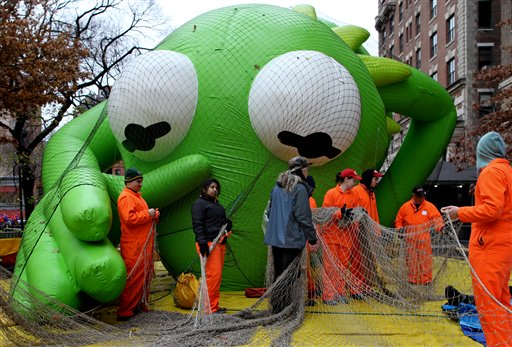 The Kermit the Frog balloon seems to reach out towards balloon handlers with Macy's department store's 85th annual Macy's Thanksgiving Day Parade as they work on another one of 15 giant helium balloons and 44 novelty and specialty balloons Wednesday, Nov. 23, 2011 that will be featured in Thursday's parade in New York.