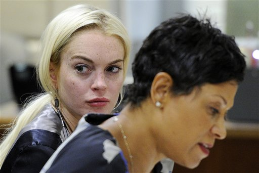 Lindsay Lohan (left) sits alongside her attorney Shawn Chapman Holley during a case review conference in Los Angeles on July 21, 2011.