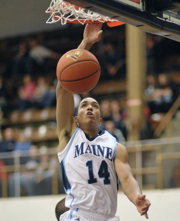 Maine's Justin Edwards (14) slams home two points in the first half of their game against UMaine Machias in Memorial Gym, Orono, Maine, on Monday Nov. 14, 2011.