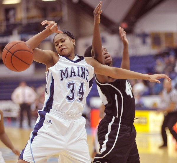 Maine forward Corinne Wellington (34) collides with Troy forward Tenia Manuel (44) on a rebound in the second half of their game in Orono on Friday, Nov. 25, 2011.