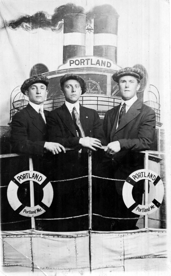 "Three well-dressed young men pose in a Portland studio, circa 1905, ""aboard"" a set evoking the ill-fated steamer Portland, lost at sea in a gale on Nov. 27, 1898, with 176 passengers and crew. From the Maine Maritime Museum Burden collection."