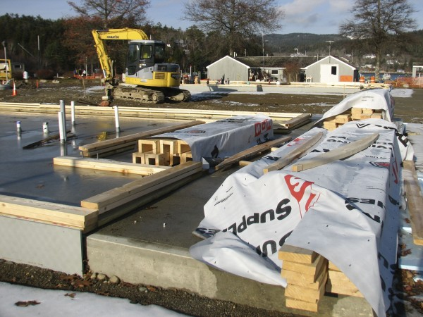 Lumber sits on a foundation poured for a new visitor's center in Northeast Harbor on Friday, Nov. 25, 2011. The new building is one of three under construction at the local marina as part of a $2.2 million marina redesign project in the Mount Desert village.