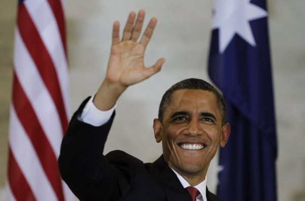 President Barack Obama waves to the public inside Parliament House in Canberra, Australia, on Wednesday.