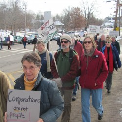 At an Occupy Brunswick event on Saturday, Nov. 26, 2011, about 40 people marched down Maine Street and spent an hour waving signs in front of the local Bank of America branch.