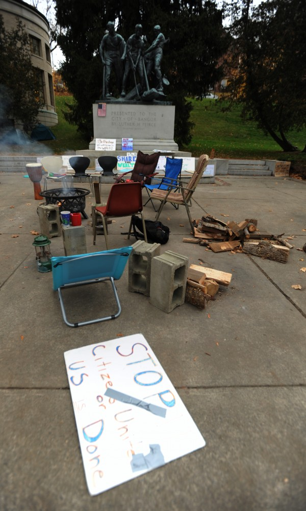 Lawn chairs, cement blocks and wood surround a campfire in Peirce Park in Bangor at the Occupy Bangor movement encampment on Wednesday, Nov. 16, 2011. City officials are drafting a letter asking occupiers to move tents off city property.