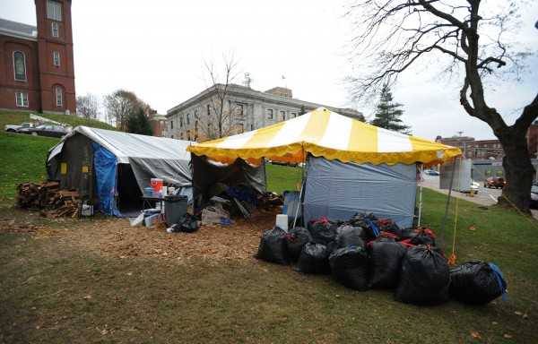 Bags of leaves and trash sit next to the Occupy Bangor food preparation tent in Peirce Park on Wednesday, Nov. 16, 2011.