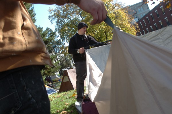 Ray Peck of Hudson helps with setting up a communal tent at the Occupy Bangor encampment on the grounds of the Bangor Public Library on Monday, Oct. 31, 2011. Although camping in Peirce Memorial Park is prohibited, a handful of Occupy Bangor activists have been camping on the adjoining grounds of the libray since Saturday night.