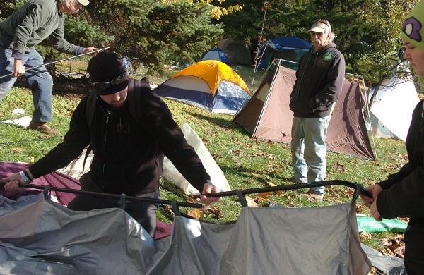 John Kreps of Appleton, Ray Peck of Hudson, Jim Freeman of Verona Island, and Kat King of North Carolina, set up a communal tent at the Occupy Bangor encampment on the grounds of the Bangor Public Library on Monday, Oct. 31, 2011. Because overnight camping is prohibited at Peirce Memorial Park, which is the gathering site for Occupy Bangor, activists have been camping on the adjoining library grounds since Saturday night.