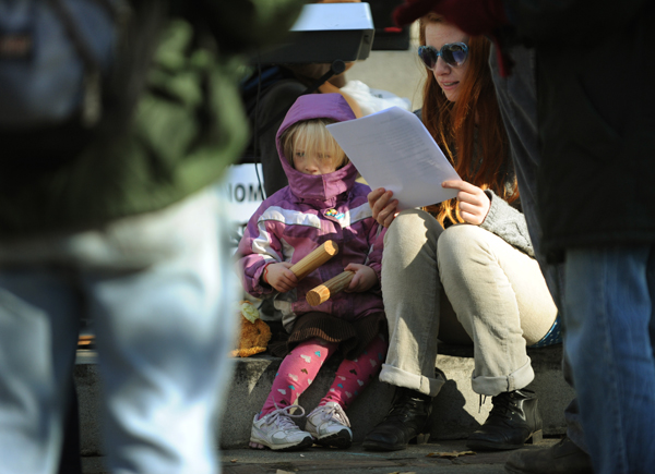 Morgan Taheny (left) and her mom, Kara Taheny, join Occupy Bangor protesters at Peirce Park in Bangor on Saturday, Nov. 5, 2011 for family day. The small group sang songs and did face paintings.