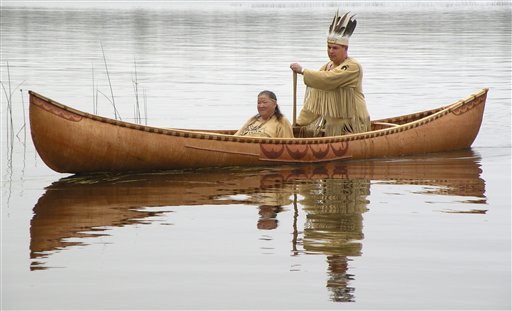 Passamaquoddy Chief Joseph Socobasin paddles a birch canoe with his grandmother Joan Dana in Indian Township last month.