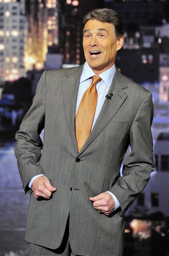 "Republican Presidential candidate Rick Perry reads the ""Top Ten"" list on the set of the ""Late Show with David Letterman,"" Thursday, Nov. 10, 2011 in New York."