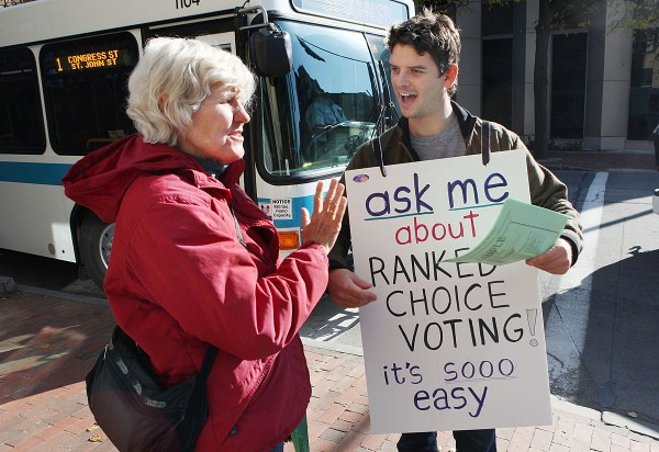 Carlin Whitehouse, of the League of Young Voters (right) speaks with Sandra Braden (left) about Ranked Choice Voting, Tuesday, Nov. 8, 2011  in Portland, Maine. The new method will be used to select Portland's first elected mayor since 1923.