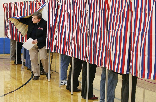 Joe Baum exits the voting booth Tuesday, Nov. 8, 2011 after voting at the Reiche School in Portland, Maine.