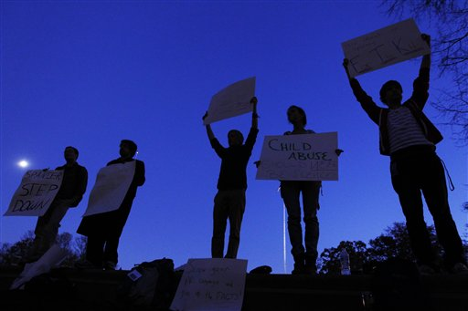 Protestors call for the resignation of Penn State University's president Graham Spanier amid a child sex-abuse scandal involving a former football assistant, Tuesday, Nov. 8, on the school's campus.