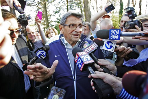 Penn State football coach Joe Paterno speaks briefly to reporters as he leaves for football practice, Tuesday, Nov. 8.