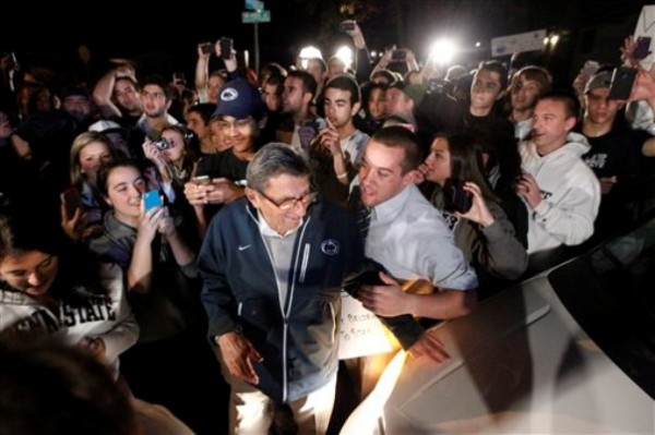 Students greet Penn State football coach Joe Paterno as he arrives at his home, Tuesday, Nov. 8, 2011, in State College, Pa. Paterno's support among the Penn State board of trustees was described as &quoteroding&quot Tuesday, threatening to end the 84-year-old coach's career amid a child sex-abuse scandal involving a former assistant and one-time heir apparent.