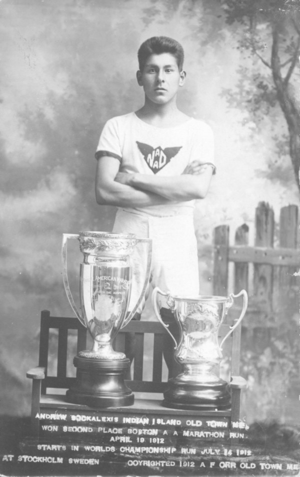 Andrew Sockalexis, Penobscot Indian running star, and two of his trophies at the height of his career.