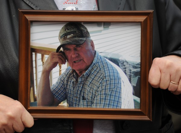 A picture of homicide victim David Trask is held by his wife, Ruth Trask, as she addresses the media outside the Penobscot County Judicial Center in Bangor on Friday, November 18, 2011.