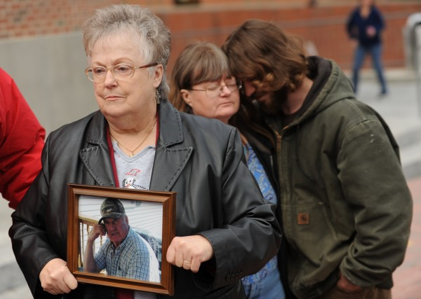 Ruth Trask, wife of David Task, displays a photograph of her late husband outside the Penobscot Judicial Center in Bangor on Friday, Nov. 18, 2011. Peter Robinson is being charged in connection with Trask's death.
