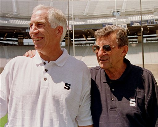 Penn State head football coach Joe Paterno, right, poses with his defensive coordinator Jerry Sandusky in 1999.