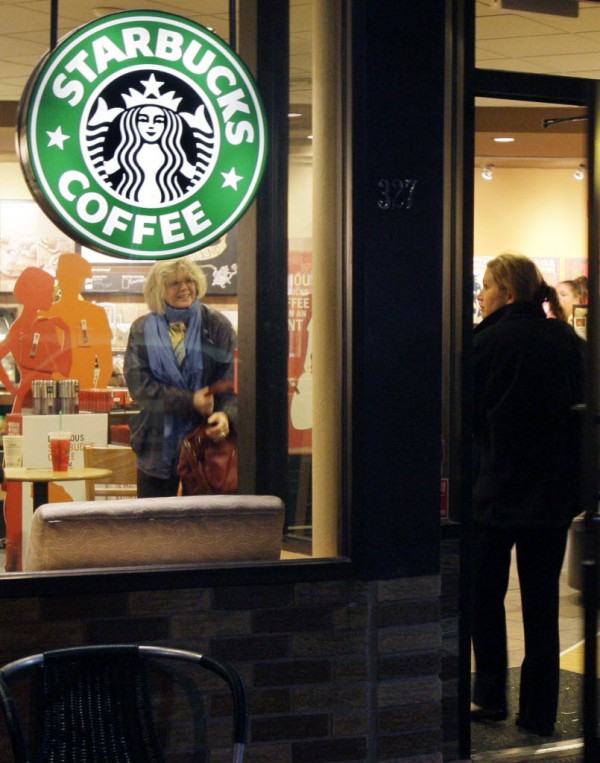 A customer enter a Starbucks coffee shop in Arlington, Mass., in 2009.