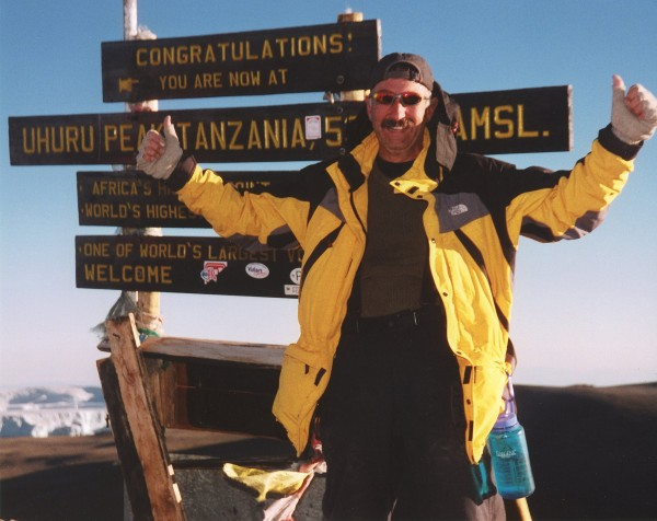 Frank Slachmans celebrates his climb up Mount Kilimanjaro. The Sacramento cardiac surgeon is one peak shy of bagging the Seven Summits, despite being afraid of heights and the time that climbing has taken him away from his family.